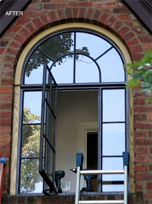 arched metal casement window after restoration